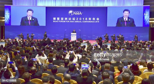 Chinese President Xi Jinping delivers a speech at an annual meeting of the Boao Forum for Asia in the southern Chinese province of Hainan on April 10...