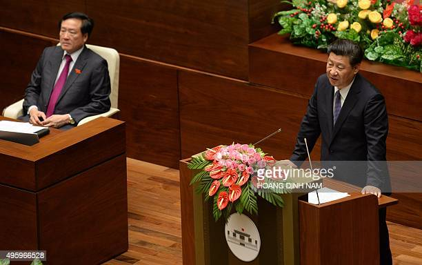 Chinese President Xi Jinping delivers a speech at Parliament House in Hanoi on November 6 2015 Xi said he hoped for a 'higher level' partnership with...