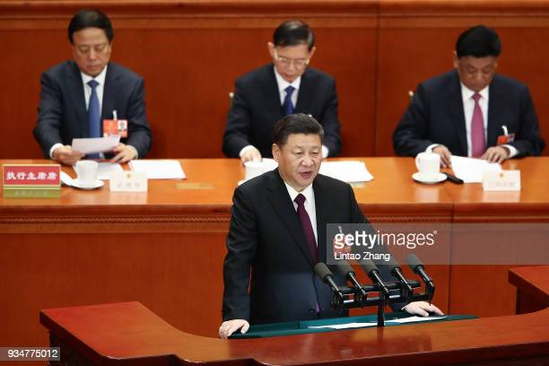 Chinese President Xi Jinping delivers a speech during the closing session of the National People's Congress at the Great Hall of the People on March...