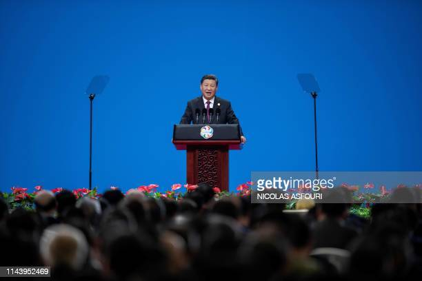 TOPSHOT Chinese President Xi Jinping delivers a speech during the opening ceremony of the Conference on Dialogue of Asian Civilizations at the...