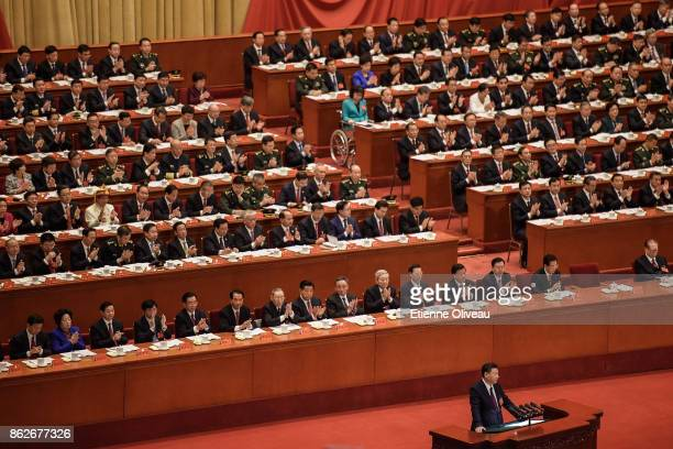 Chinese President Xi Jinping delivers a speech while members of the Communist Party Of China applause during the opening session of the 19th...