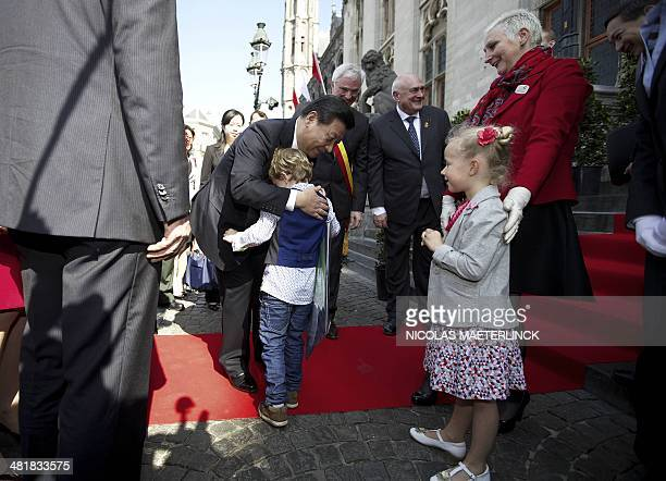 Chinese President Xi Jinping embraces children in Bruges on April 1 during his official visit to Belgium Chinese leader Xi Jinping on the last leg of...