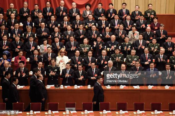 Chinese President Xi Jinping, followed by Chinese former Presidents Jiang Zemin and Hu Jintao attend the opening session of the 19th Communist Party...