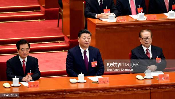 Chinese President Xi Jinping former presidents Hu Jintao and Jiang Zemin attend during the opening session of the 19th Communist Party Congress held...