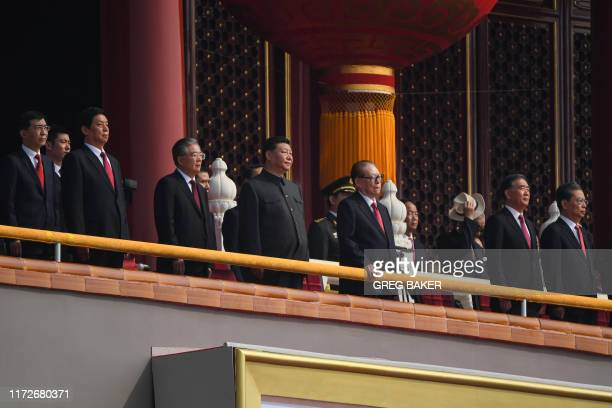 Chinese President Xi Jinping , former presidents Jiang Zemin and Hu Jintao attend a military parade at Tiananmen Square in Beijing on October 1 to...
