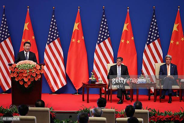 Chinese President Xi Jinping gives a speech as US Secretary of Treasury Jack Lew and US Secretary of State John Kerry listening during the opening...