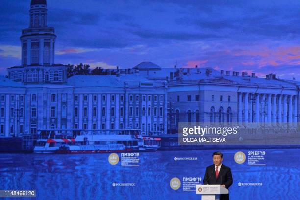 Chinese President Xi Jinping gives a speech during a plenary session of the St Petersburg International Economic Forum in Saint Petersburg on June 7...