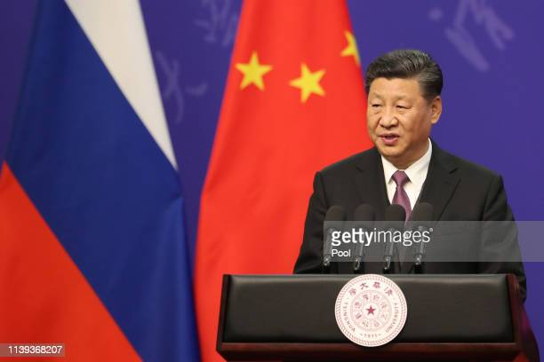 Chinese President Xi Jinping gives a speech during the Tsinghua Universitys ceremony for Russian President Vladimir Putin unseen at Friendship Palace...