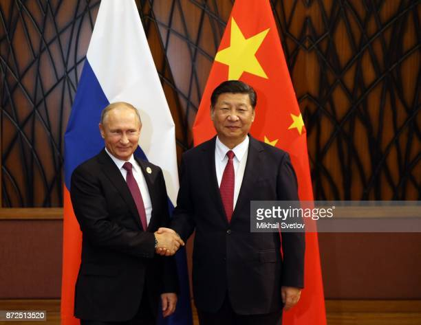 Chinese President Xi Jinping greets Russian President Vladimir Putin during their bilateral meeting at the AsiaPacific Economic Cooperation Leaders...