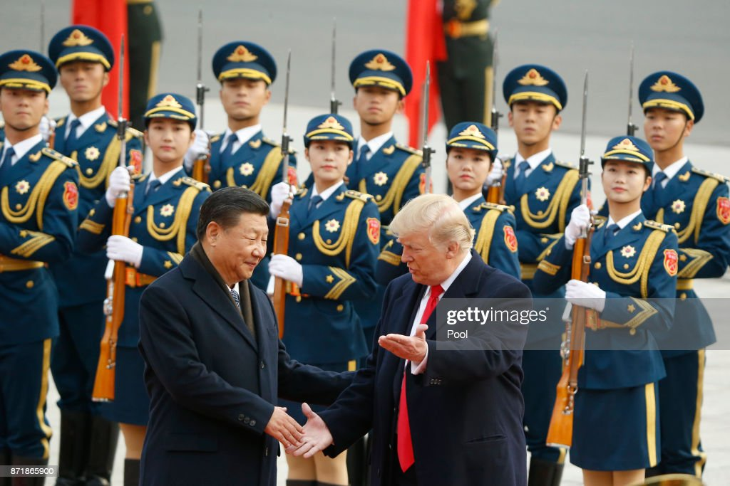 Chinese President Xi Jinping greets U.S. President Donald Trump at a welcoming ceremony November 9, 2017 in Beijing, China. Trump is on a 10-day trip to Asia.