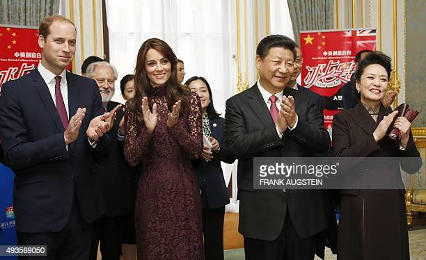 Chinese President Xi Jinping his wife his wife Peng Liyuan Britain's Catherine Duchess of Cambridge and her husband Britain's Prince William Duke of...