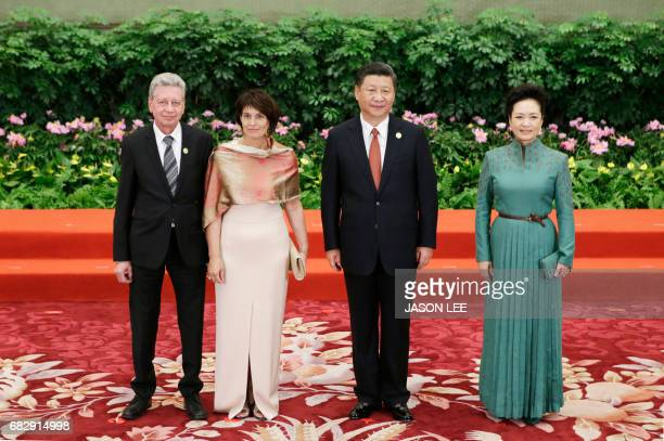 Chinese President Xi Jinping, his wife Peng Liyuan, Swiss President Doris Leuthard and her husband Roland Hausin attend the welcoming banquet for the...