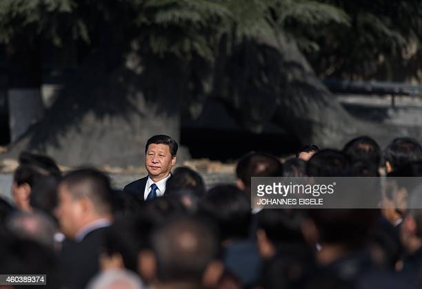Chinese President Xi Jinping holds a speech during a memorial ceremony at the Memorial Hall of the Victims in Nanjing Massacre by Japanese Invaders...