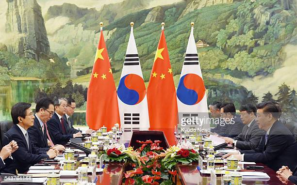 Chinese President Xi Jinping holds talks with South Korean Prime Minister Hwang Kyo Ahn at the Great Hall of the People in Beijing on June 29 2016 Xi...