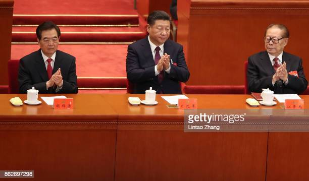 Chinese President Xi Jinping Hu Jintao China's former president and China's former president Jiang Zemin attend the opening session of the Chinese...
