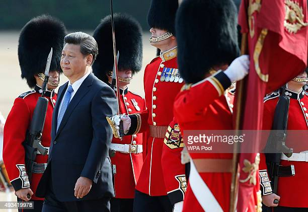 Chinese President Xi Jinping inspects a guard of honour during the official welcome ceremony at Horseguards Parade on October 20 2015 in London...