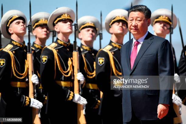 Chinese President Xi Jinping inspects Russian honour guards during a welcoming ceremony upon his arrival at Moscow's Vnukovo airport on June 5 as he...