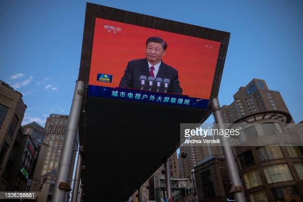Chinese President Xi Jinping is seen on a big screen showing the Chinese state television CCTV evening news as the city gets ready for the upcoming...
