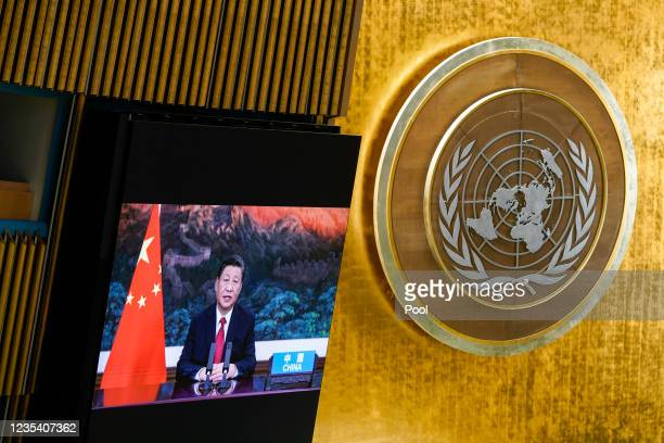 Chinese President Xi Jinping is seen on a video screen as he addresses the annual gathering in New York City for the 76th session of the United...