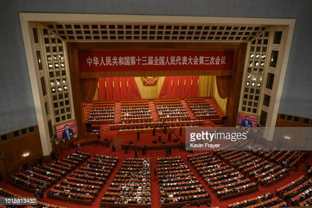 Chinese president Xi Jinping is seen on large screens as Communist Party delegates take part in a session after voting on a new draft security bill...