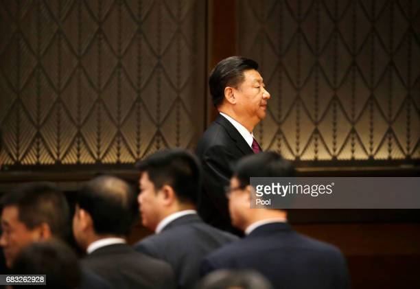 Chinese President Xi Jinping leaves a news conference at the end of the Belt and Road Forum for International Cooperation on May 15 2017 in Beijing...
