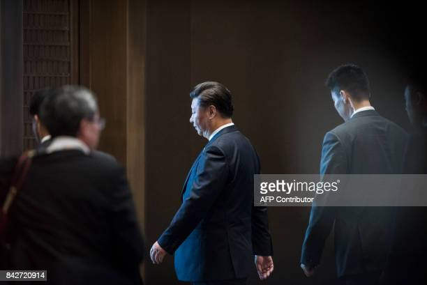 Chinese President Xi Jinping leaves after a press conference at the BRICS Summit in Xiamen Fujian province on September 5 2017 Xi opened the annual...
