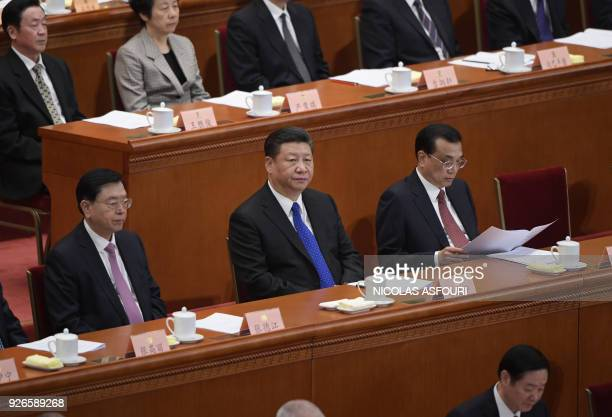 Chinese President Xi Jinping listens to Chairman of the National Committee of the Chinese People's Political Consultative Conference Yu Zhengsheng's...