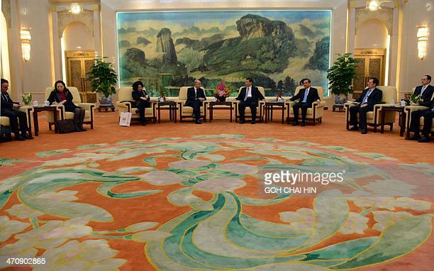 Chinese President Xi Jinping listens to French Foreign Minister Laurent Fabius during a meeting at the Great Hall of the People in Beijing on...
