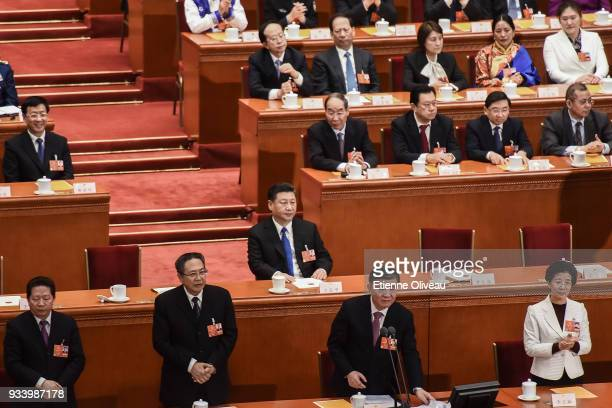 Chinese President Xi Jinping looks on after he casted his vote during the seventh plenary session of the 13th National People's Congress at the Great...
