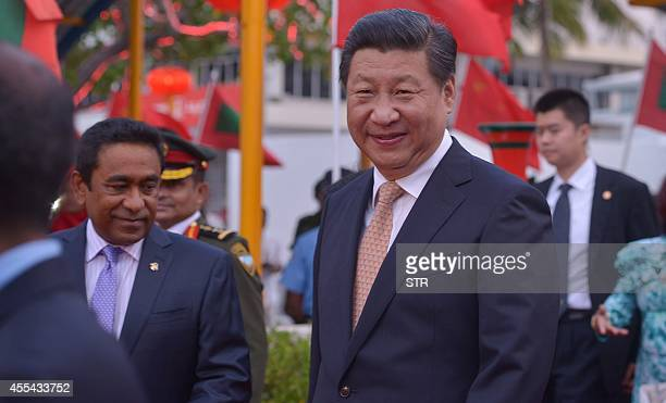 Chinese President Xi Jinping looks on as he arrives alongside Maldivian President Abdulla Yameen near the capital Male in the Maldives on September...