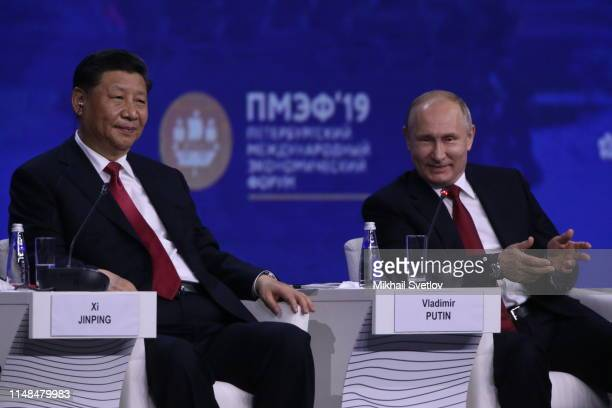 Chinese President Xi Jinping looks on Russian President Vladimir Putin during the plenary meeting at the SPIEF 2019 Saint Petersburg International...