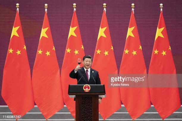 Chinese President Xi Jinping makes a toast at a dinner party of a summit on the country's Belt and Road crossborder infrastructure development...