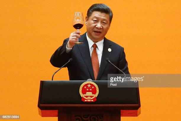 Chinese President Xi Jinping makes a toast at the beginning of the welcoming banquet at the Great Hall of the People during the first day of the Belt...