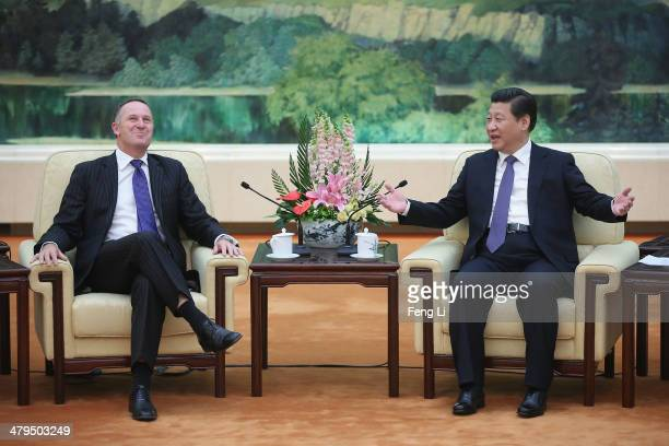 Chinese President Xi Jinping meets New Zealand Prime Minister John Key at the Great Hall of the People on March 19 2014 in Beijing China The two...
