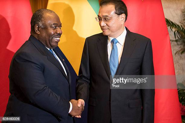 Chinese President Xi Jinping meets with Gabon's President Ali Bongo Ondimba on December 8 2016 in Beijing China