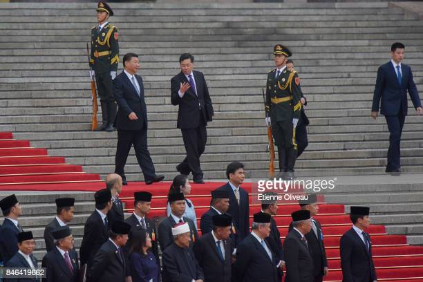 Chinese President Xi Jinping passes by the Brunei delegation during a welcoming ceremony outside the Great Hall of the People on September 13 2017 in...