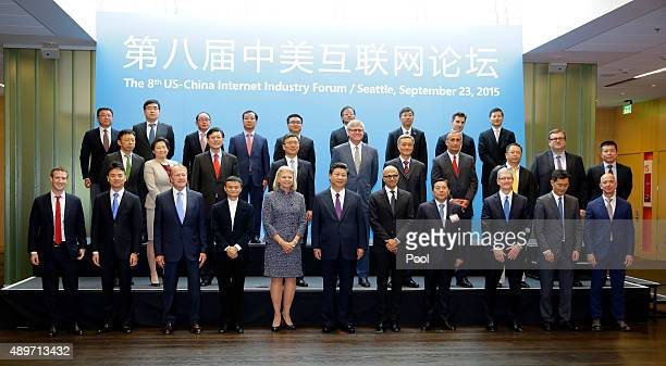 Chinese President Xi Jinping poses for a photo with a group of CEOs and other executives at the main campus of Microsoft Corp September 23 2015 in...