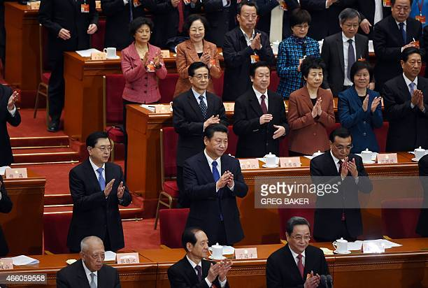 Chinese President Xi Jinping Premier Li Keqiang and Chairman of the Standing Committee of the National People's Congress Zhang Dejiang applaud at the...