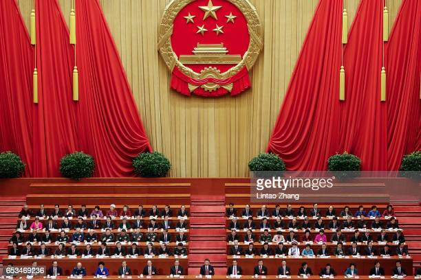 Chinese President Xi Jinping Premier Li Keqiang and Chairman of the National Committee of the Chinese People's Political Consultative Conference Yu...