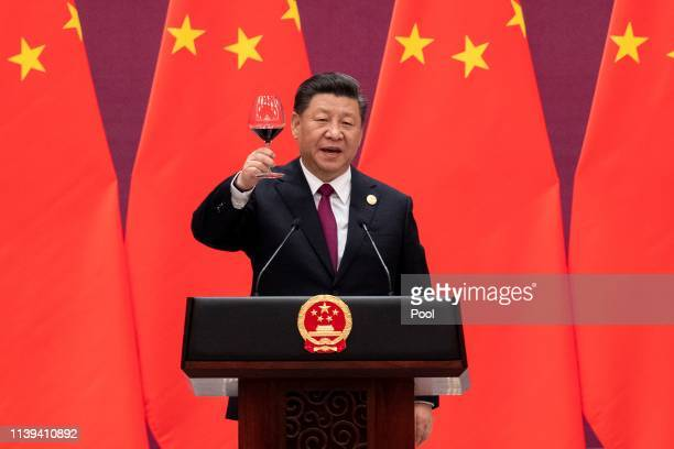 Chinese President Xi Jinping proposes a toast during the welcome banquet for leaders attending the Belt and Road Forum at the Great Hall of the...