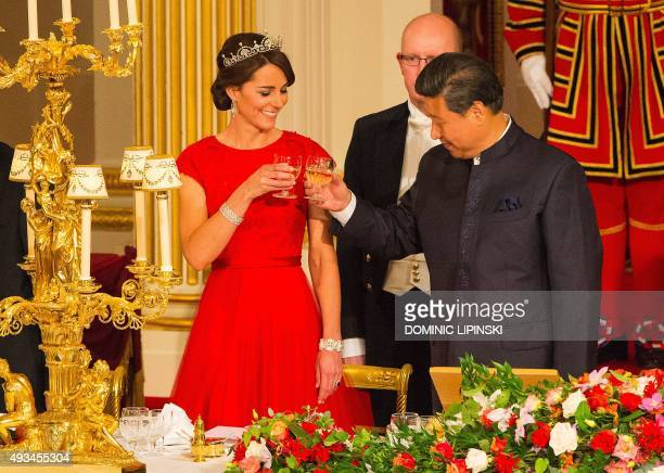 Chinese President Xi Jinping raises a glass with Britain's Catherine Duchess of Cambridge during State Banquet hosted by Britain's Queen Elizabeth II...