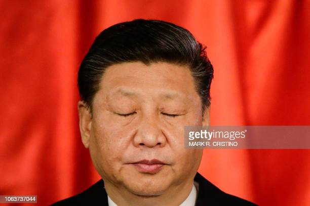 Chinese President Xi Jinping reacts during a joint press statement with Philippines' President Rodrigo Duterte at the Malacanang Presidential Palace...