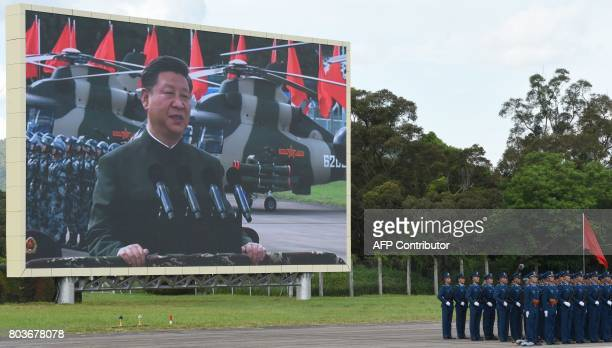 Chinese President Xi Jinping reviews troops from a car during a military parade in Hong Kong on June 30 2017 Xi tours a garrison of Hong Kong's...