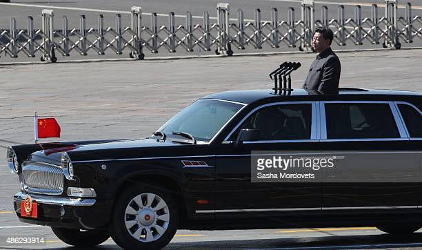BEIJING CHINA SEPTEMBER 3 Chinese President Xi Jinping rides a car by the Tiananmen Square during during a military parade to mark the 70th...