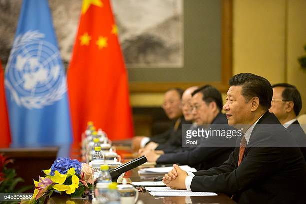 Chinese President Xi Jinping right listens as UN Secretary General Ban Kimoon not shown speaks during a meeting at the Diaoyutai State Guesthouse on...