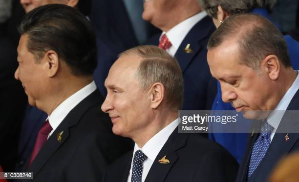 Chinese President Xi Jinping Russian President Vladimir Putin and Turkish President Recep Tayyip Erdogan pose for a family photo during the G20...