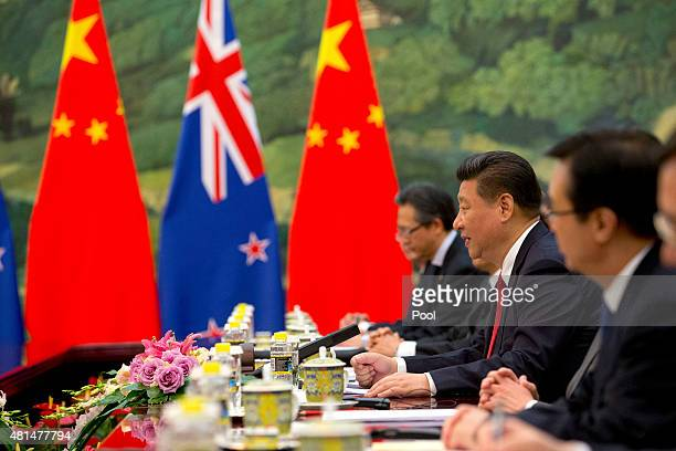 Chinese president Xi Jinping second from right speaks during a bilateral meeting with New Zealand's GovernorGeneral Sir Jerry Mateparae not shown at...