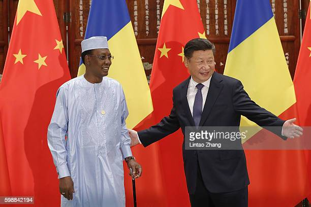 Chinese President Xi Jinping shake hands with Chad President Idriss Deby Itno before during their meeting at the West lake State Guest House on...