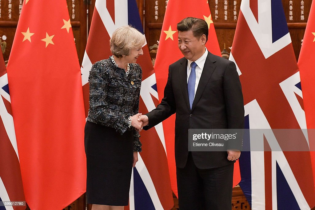 Chinese President Xi Jinping (R) shakes hand with British Prime Minister Theresa May (L) before their meeting at the West Lake State House on September 5, 2016 in Hangzhou, China. World leaders have gathered in Hangzhou for the 11th G20 Leaders Summit from September 4 to 5.