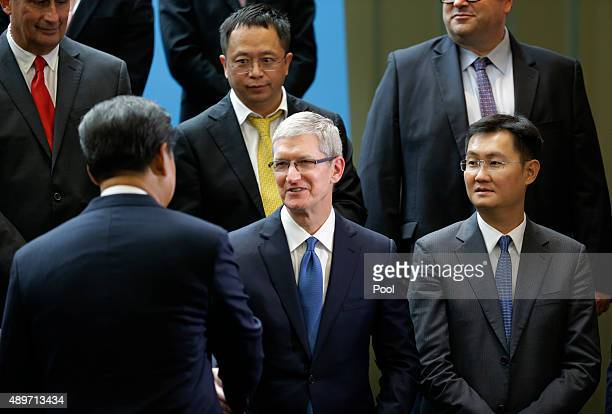 Chinese President Xi Jinping shakes hands with Apple CEO Tim Cook as Tencent's Pony Ma looks on during a gathering of CEOs and other executives at...